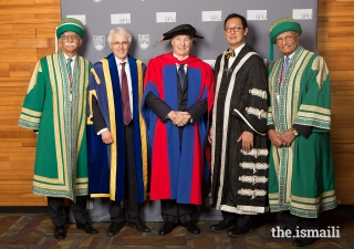 AKU President Firoz Rasul, SFU President and Vice-Chancellor Andrew Petter, Mawlana Hazar Imam, UBC President and Vice-Chancellor Santa Ono, and University of Central Asia Board of Trustees Chairman Shams Kassim-Lakha pose for a ceremonial picture.