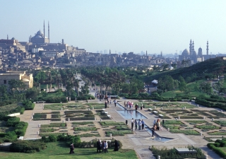 Al-Azhar park in Cairo features walkways, fountains, lawns, and gardens overlooking a lake in the traditional chahar bagh style.