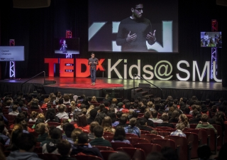 Danish Dhamani, CEO of Orai, presenting a TEDx talk on public speaking.