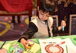 A young boy colors in the Early Childhood section of the Reflections Lounge on July 11, 2017.