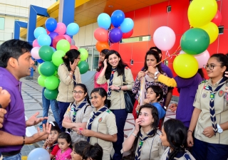 Aga Khan Scouts and Guides and volunteers from Oxygen Management Consultants prepare to spread smiles at the Rashid Hospital Trauma Center on the New Year's Eve. Habib Hussain