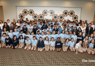 Students, parents and chaperons from The Lovett School pose for a picture to remember their visit.