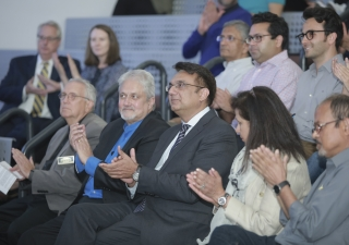 Dean Cole of the School of Architecture and Construction Management at KSU, and Prof Khan, Distinguished Professor of Architecture and Historic Preservation at Roger Williams University, listen to the introduction by Pres Murad Abdullah, at the event.