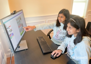 Simal and Sophia Ali creating a flyer in Canva.