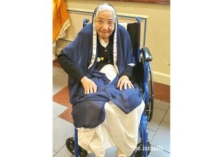 "Fatima Jamani (""Maaji"") in her volunteer uniform at Ismaili Center and Jamatkhana in Atlanta."