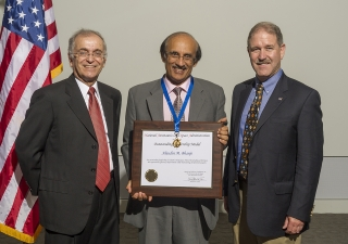 Alaudin Bhanji being presented with the Outstanding Leadership Award from NASA, by the Director of the Jet Propulsion Laboratory, Dr. Charles Elachi (L); and Dr. John M. Grunsfeld, Associate Administrator, Science Mission Directorate, NASA.