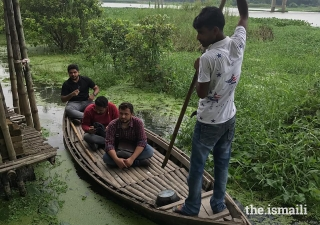 Participants enroute, via boat, to the Arcadia Education Project. The school, which won the 2019 Award, is an amphibious structure, built on land, that is flood-prone.