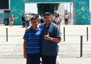 Qayl and Riyaan Maherali in front of the entrance to the Darbar site.