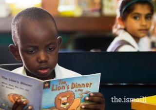 A student reading at the Aga Khan Academy Mombasa.