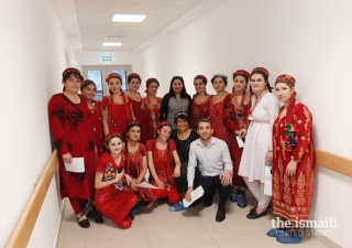 Yasmin Walji (center) celebrating Dec 13, 2019, Mawlana Hazar Imam's birthday and one year of the opening of the Outpatient Department with AKMCK team members.