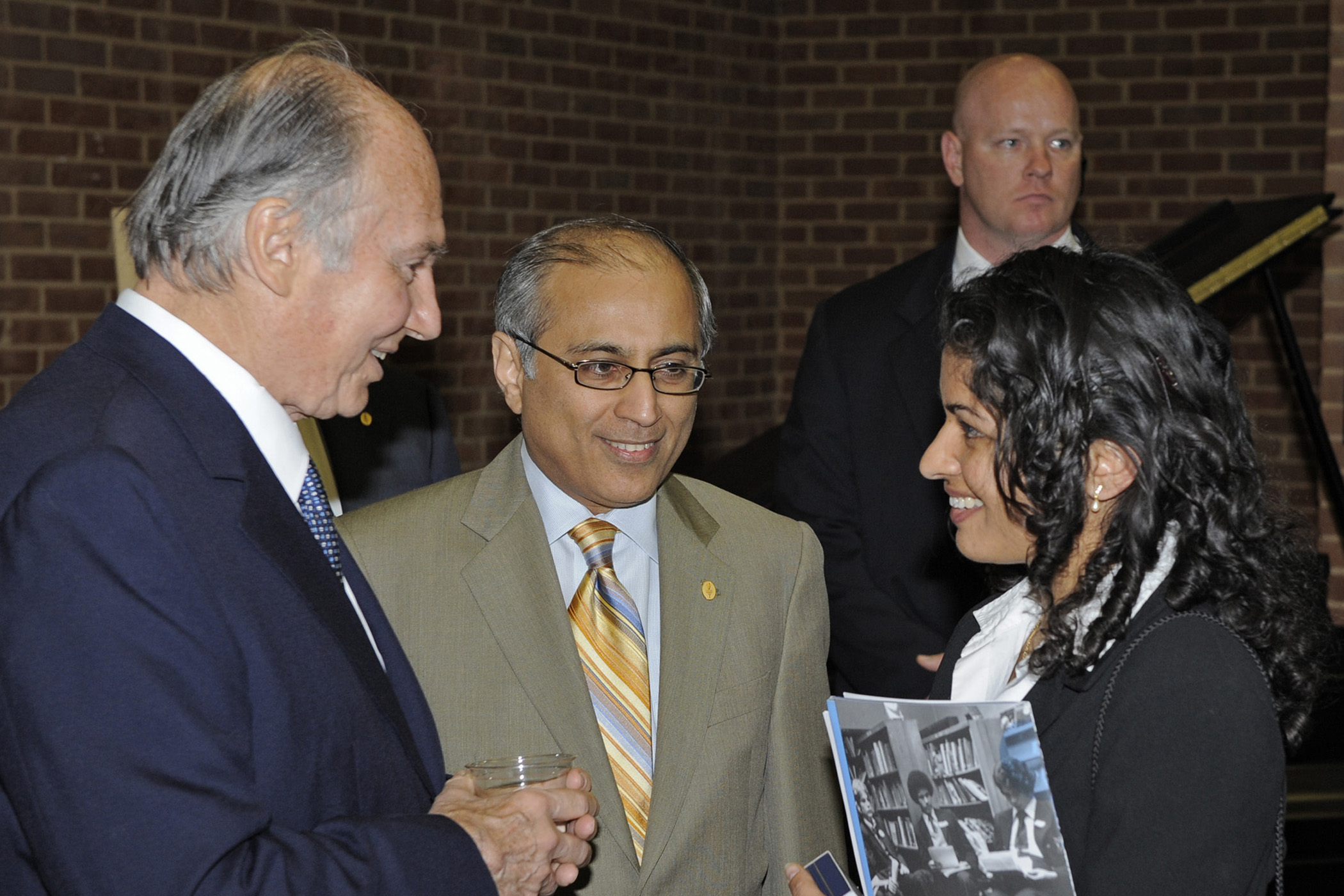 Mawlana Hazar Imam in conversation with an Ismaili involved in the field of Education at the reception following the IBO meeting. Salim Bhatia, Director of the Aga Khan Academies Programme looks on. Photo: Gary Otte