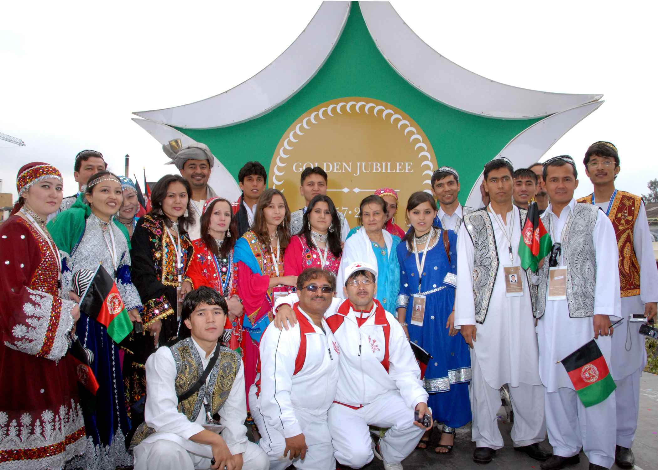 Athletes from several countries spontaneously gathered for a photograph following the Opening Ceremony of the Golden Jubilee Games. Photo: Rahim Khoja (Hakim Sons)