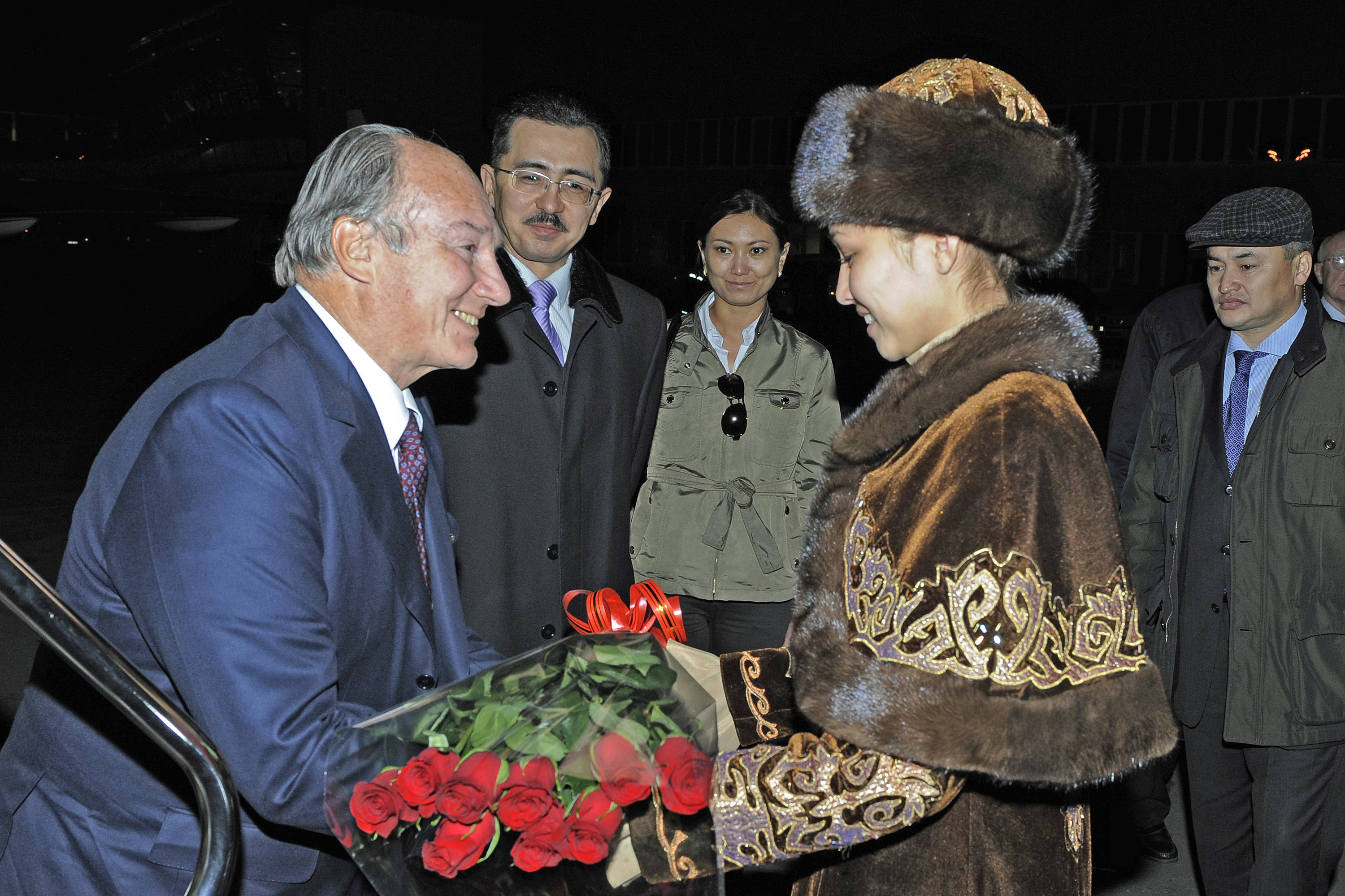 Arriving in Astana at the start of his Golden Jubilee visit to Kazakhstan, Mawlana Hazar Imam is greeted with a traditional Kazakh welcome as government officials look on. Photo: Gary Otte