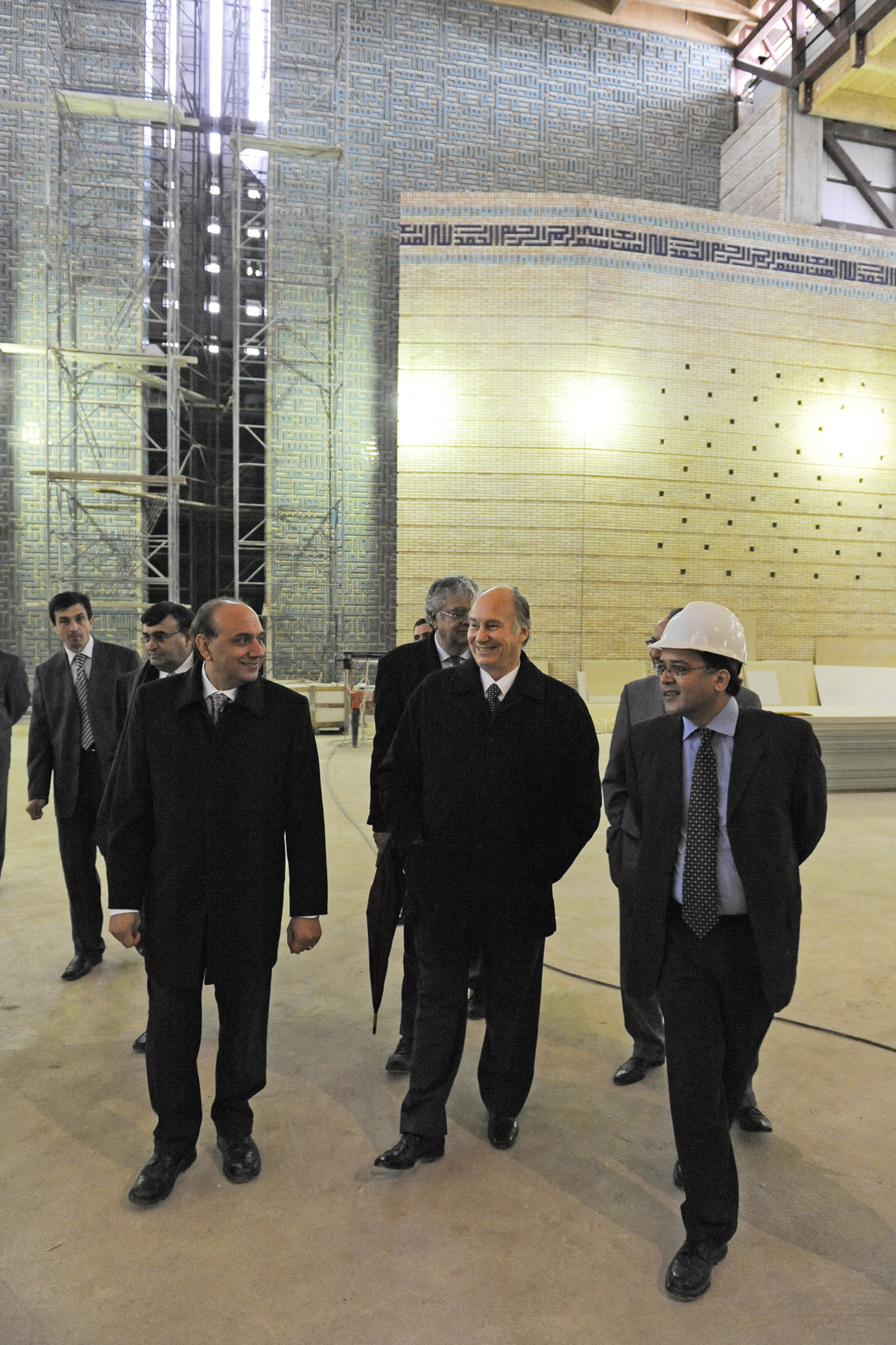 Mawlana Hazar Imam tours the prayer hall of the soon to be completed Ismaili Centre Dushanbe. He is accompanied by the building's Chief Architect and the Project Manager. Photo: Gary Otte