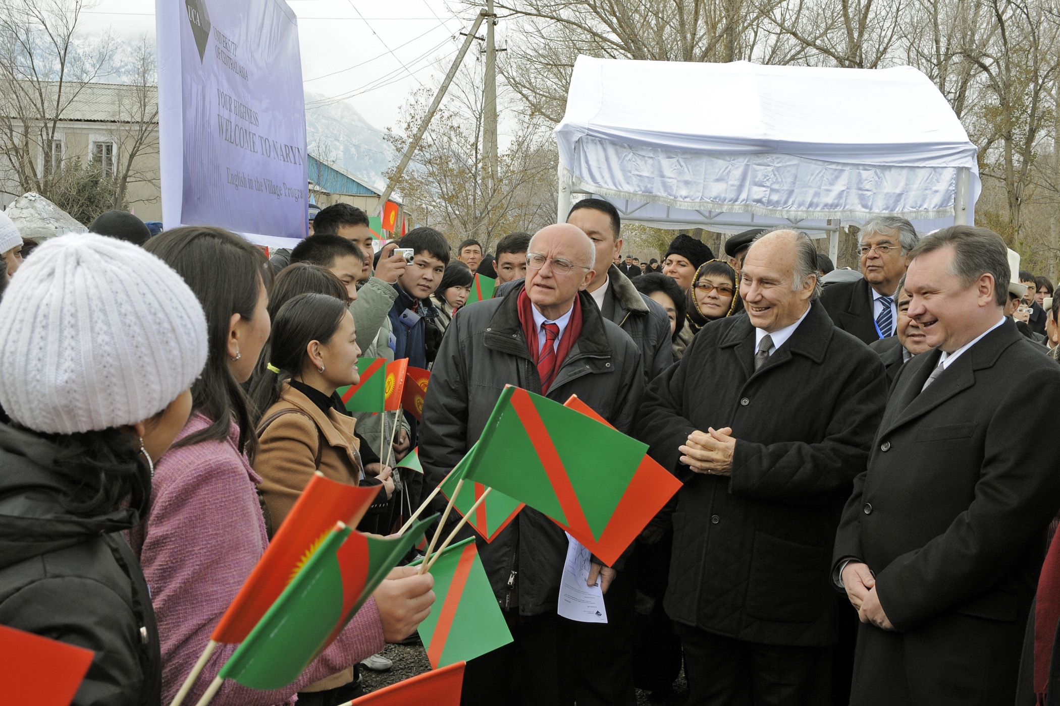 Mawlana Hazar Imam, Prime Minister Chudinov and other UCA and government officials receive a warm welcome from students at the University's town campus in Naryn. Photo: Gary Otte
