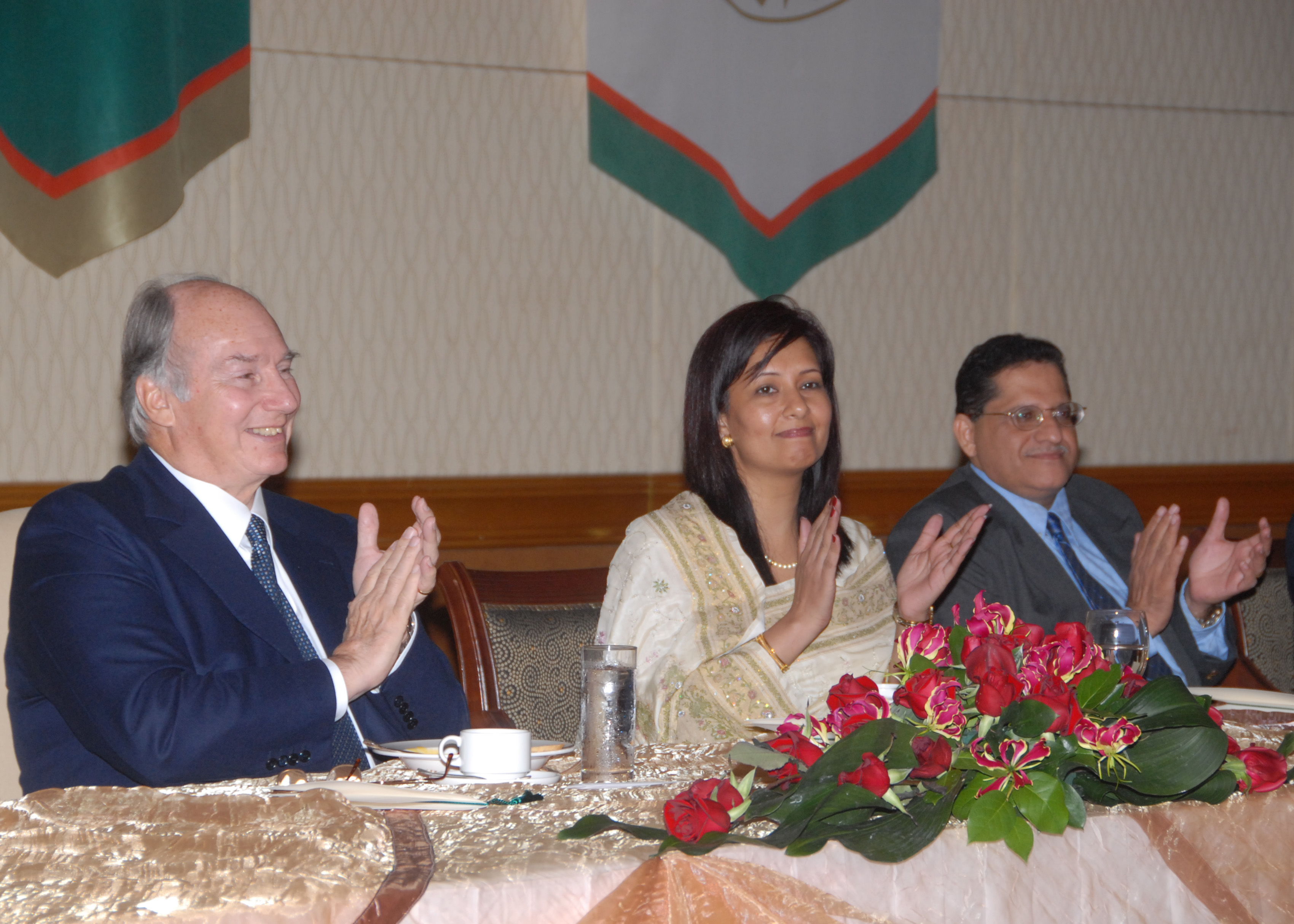 Mawlana Hazar Imam is joined in applause by Presidentbanoo and the Vice-President of the Ismaili Council for Malaysia and Singapore, during a luncheon hosted by the Jamati institutions. Photo: Akbar Hakim
