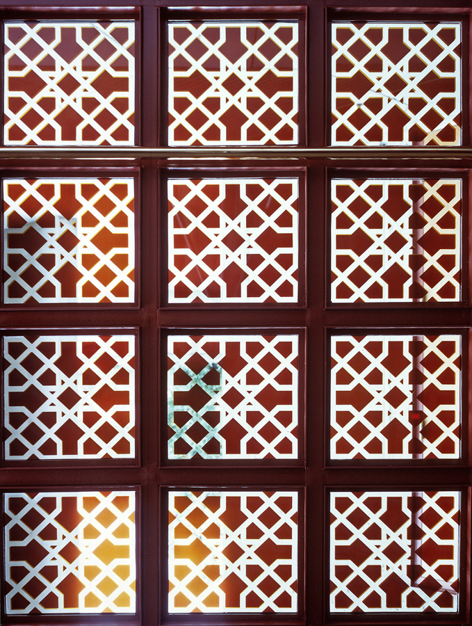 A detailed view of the window pane reveals intricate Islamic geometric patterns. Photo: Garry Otte