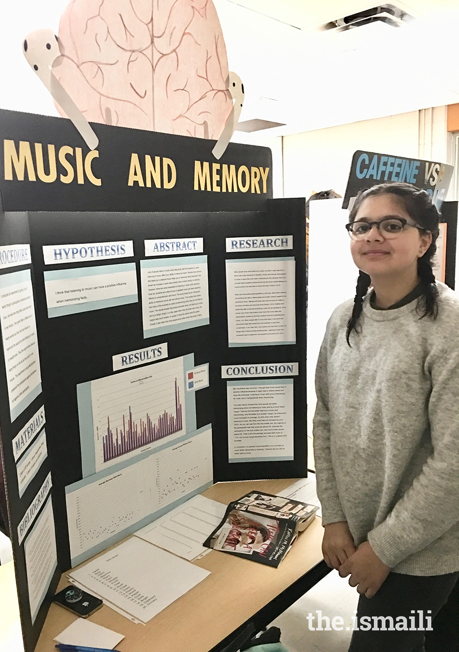 Mishka Nazarani poses next to a display of her music and memory experiment.