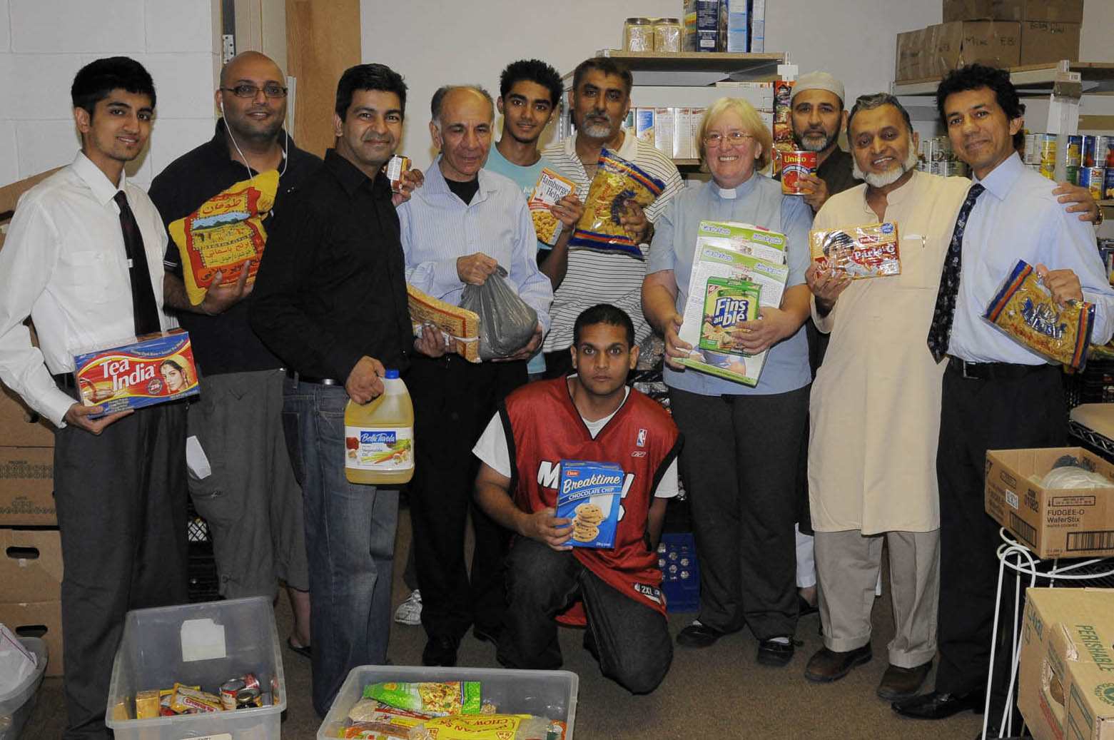 Volunteers from the Ismaili community and the Islamic Society of Toronto with Rev Helena-Rose Houldcroft, Director of the Flemingdon Park Ministry, at the food bank. Photo: Moez Visram