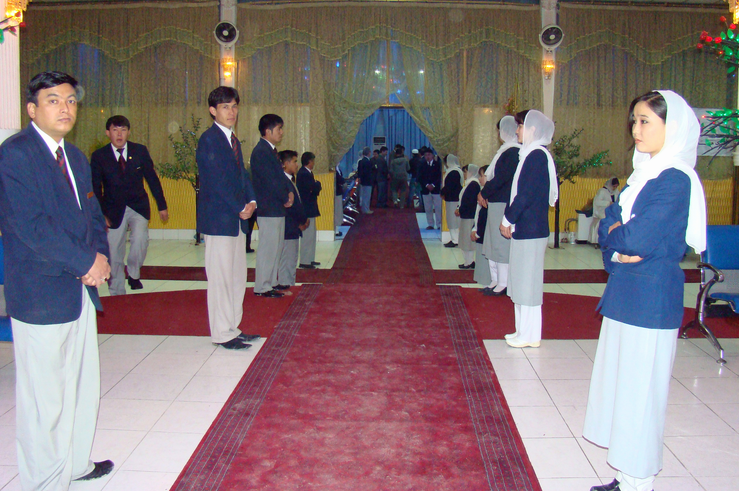 Jamati volunteers line up to welcome guests at Uranus Hall in Kabul for the commemoration of <i>Mowlud-e-Sharif</i>, the birthday of Prophet Muhammad (peace be upon him and his family). Photo: Courtesy of the Ismaili Council for Afghanistan