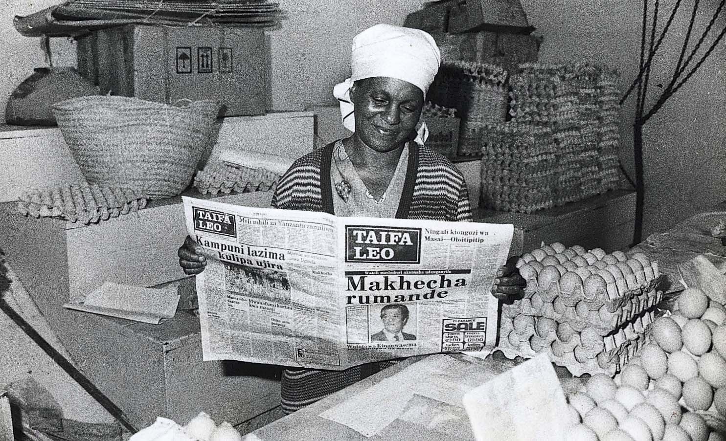 A woman reads Taifa Leo, the Nation Media Group's Kiswahili-language daily. Photo: Courtesy of Nation Media Group