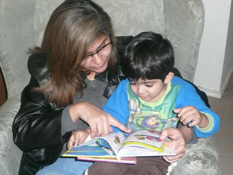 Laila Gilani reading to her youngest son, Rayan. Photo: Courtesy of Laila Gilani