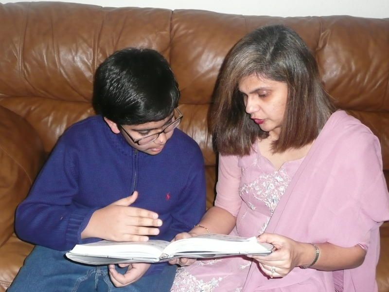 Laila Gilani and her elder son, Mazzaum, talk about a book that he has just read. Photo: Courtesy of Laila Gilani