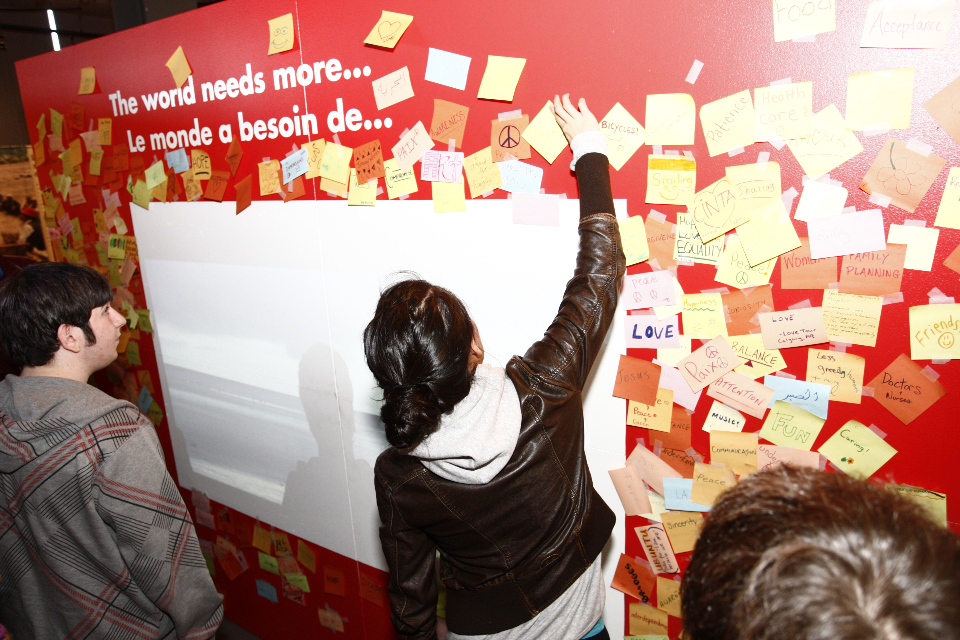 "Visitors were invited to complete the sentence ""The world needs more..."" and post it on the wall or online at the Bridges that Unite website. Photo: Courtesy of Aga Khan Foundation Canada"