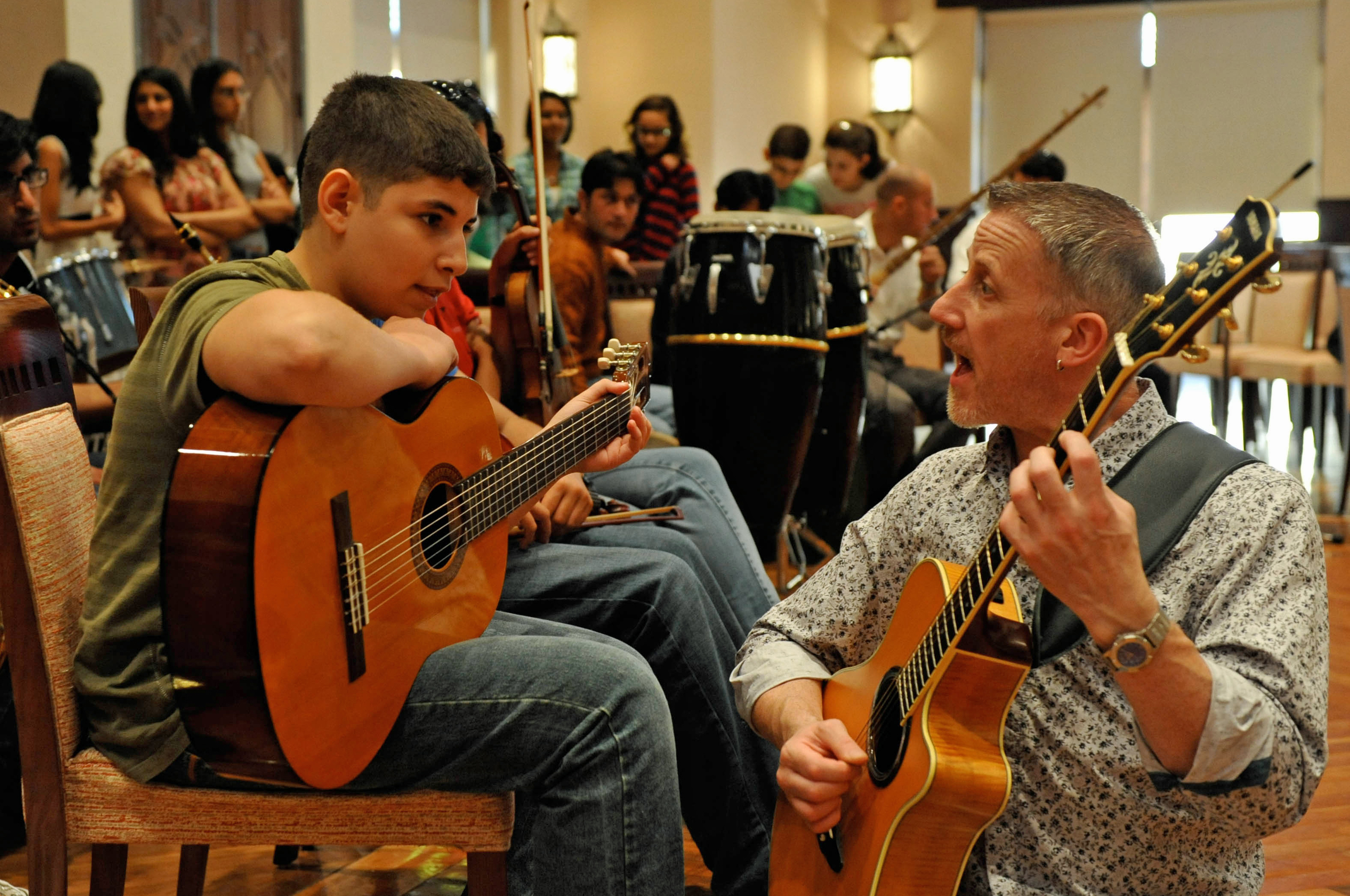 During rehearsal, Paul Griffiths works with a Syrian musician from the UAE Jamat.  . Photo: Naveed Osman