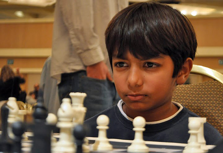 Danial Asaria plays an intense game at a national US chess championship. Photo: MonRoi