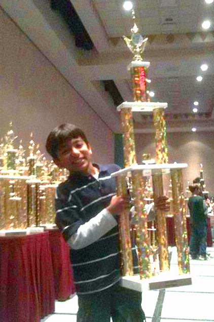 Danial Asaria celebrates with with his trophy at the US National K12 Championships. Photo: Courtesy of the Asaria Family