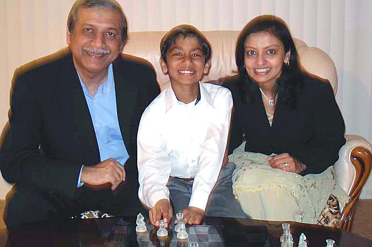 The Asarias with their young chess champion. Photo: Courtesy of the Asaria Family
