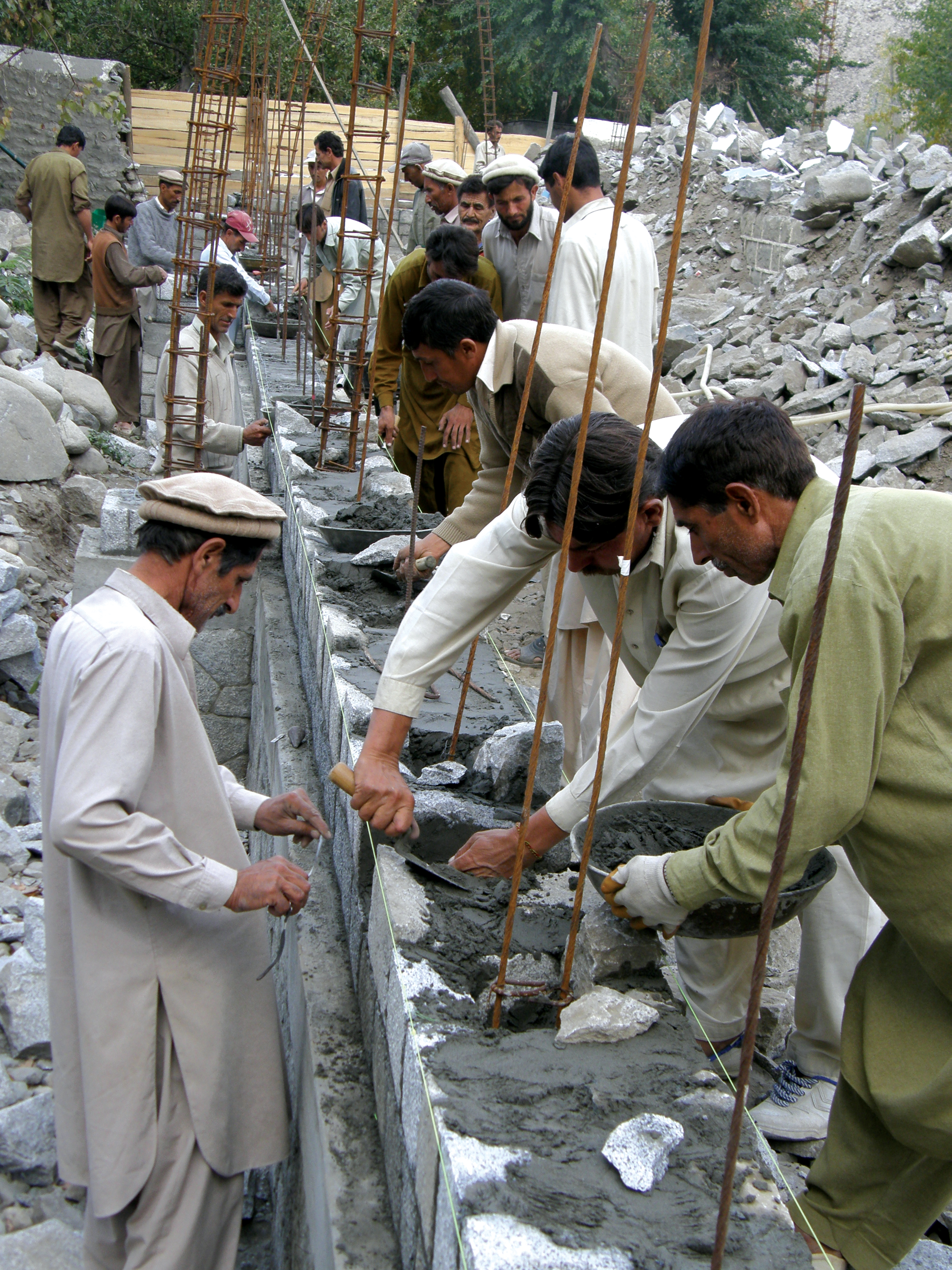 Members of the Jamat in Northern Pakistan uphold a long tradition of taking part in the construction of a new Jamatkhana. Photo: Courtesy of AKPBS, Pakistan
