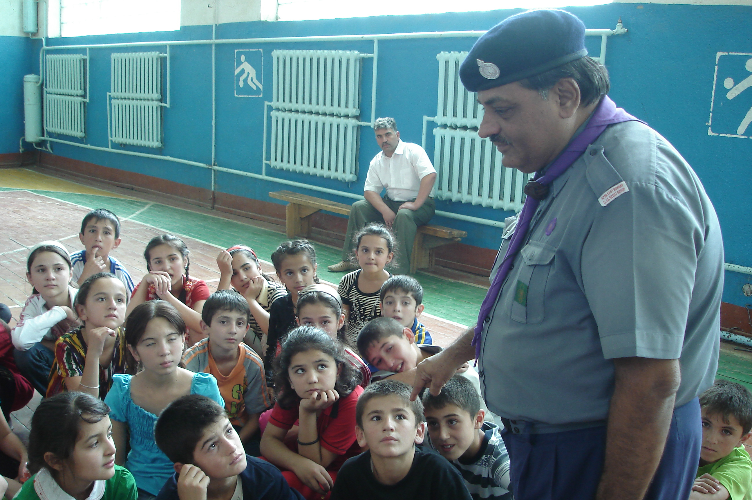 Scouts vetran Karim Moledina explains the importance of Scouting and Guiding to students at the Aga Khan Lycee in Khorog, Tajikistan. Photo: Courtesy of Karim Moledina
