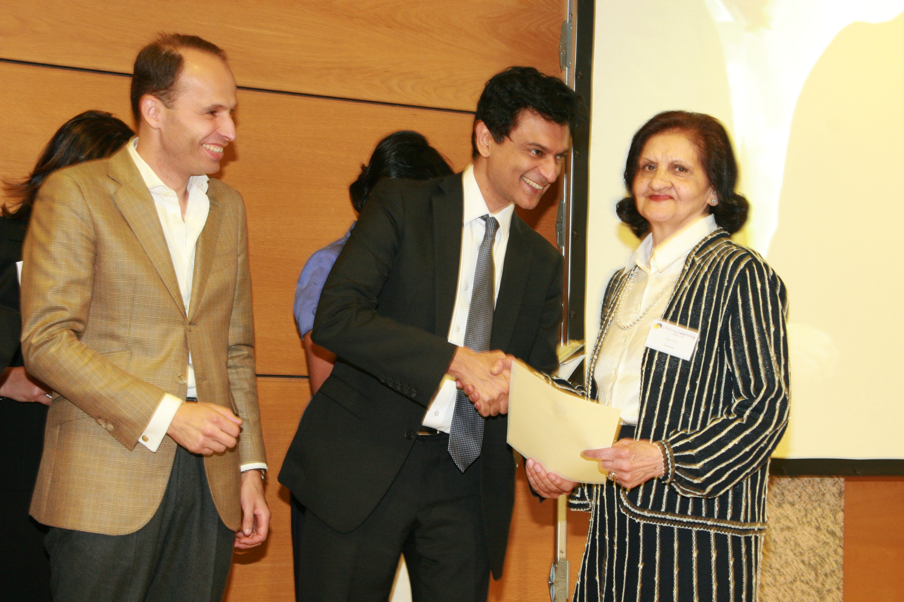 Professor Bhimani and Minister Soares award a Lifelong Learning Certificate to one of the eldest graduates in the programme. Photo: Phirbhai