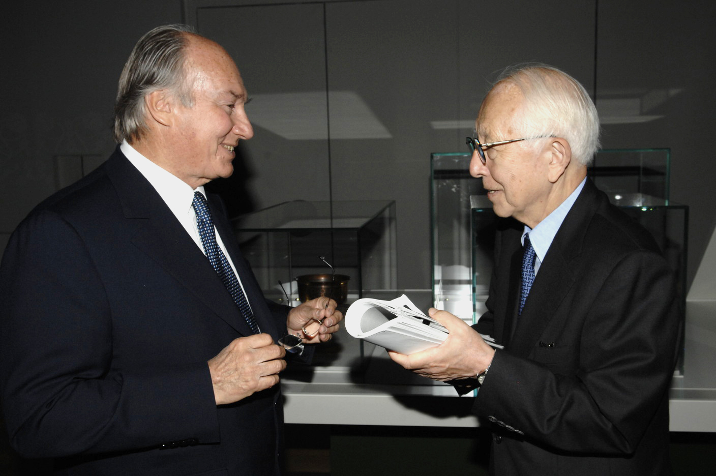 Mawlana Hazar Imam with architect Fumihiko Maki at an Aga Khan Museum Exhibition held at the Louvre in 2007. The renowned Japanese architect has served twice on the Master Jury of the Aga Khan Award for Architecture, and designed both the Aga Khan Museum in Toronto and the Delegation of the Ismaili Imamat in Ottawa. Photo: AKDN / Gary Otte