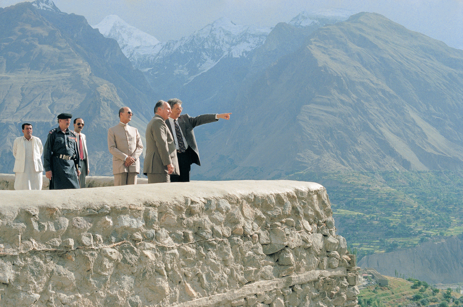 Mawlana Hazar Imam and Prince Amyn take in a view of the mountainous Hunza valley from the vantage point of the 700-year-old Baltit Fort, whose restoration by the Historic Cities Programme of the Aga Khan Trust for Culture began in 1992. Photo: AKDN / Gary Otte