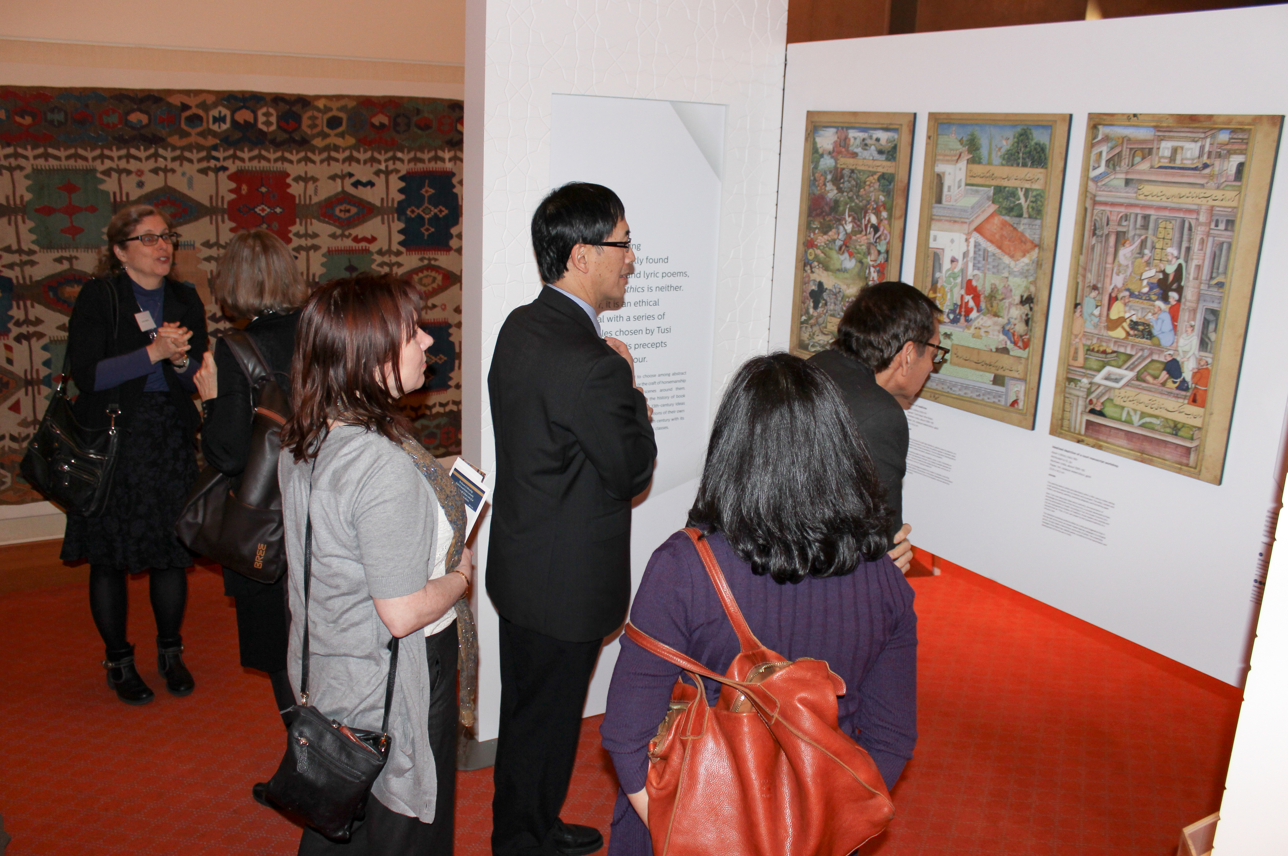 Visitors take in an exhibition on Nasir's Ethics, a manuscript in the Aga Khan Museum collection. Photo: Hakam Bhaloo
