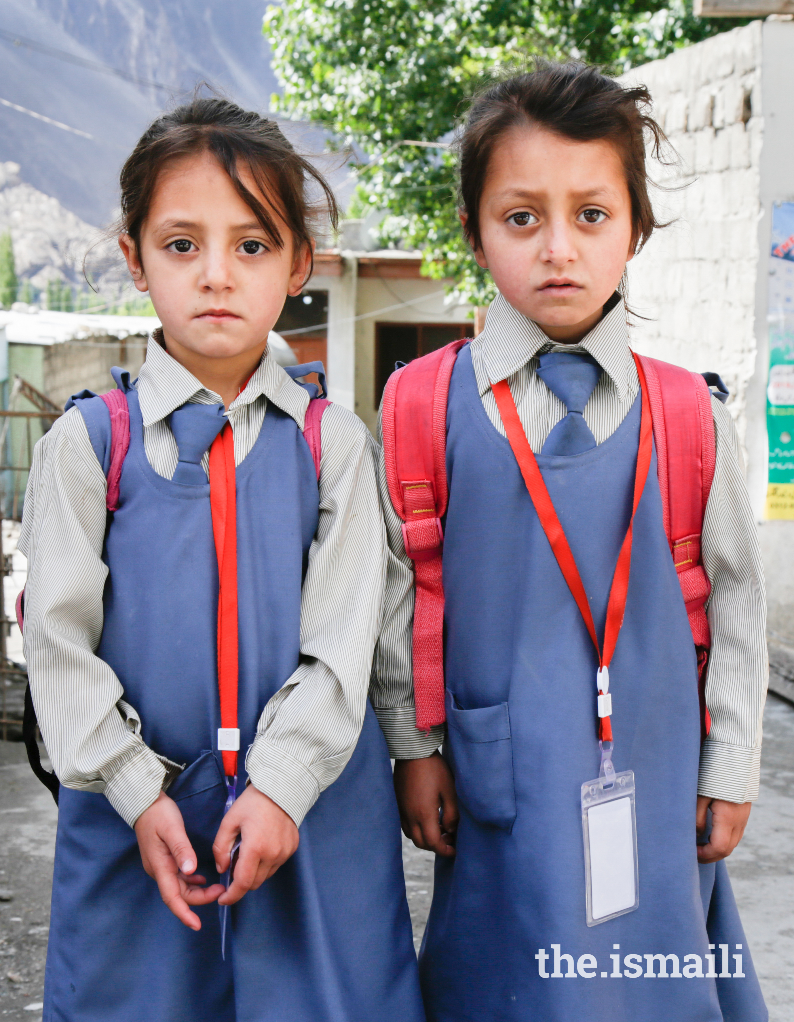 Young Ismaili sisters, Sohana (grade 1) and Fiza (ECD-2), on their way to a school in Aliabad, Hunza.