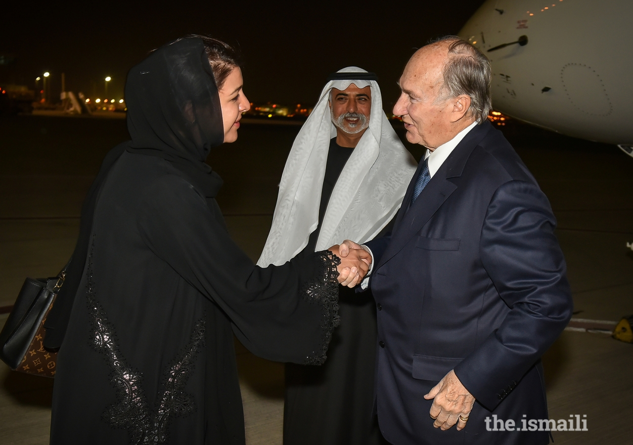 Mawlana Hazar Imam is welcomed by Her Excellency Reem Bint Ebrahim Al Hashimy, Cabinet Member and Minister of State for International Cooperation, and His Excellency Sheikh Nahayan Bin Mabarak Al Nahayan, Minister for Tolerance upon his arrival in Dubai.