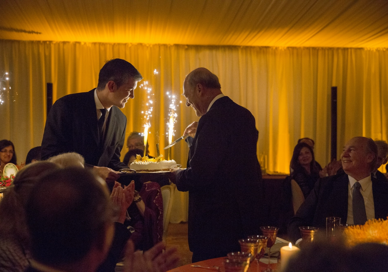 Prince Amyn cuts his birthday cake, as Mawlana Hazar Imam looks on.
