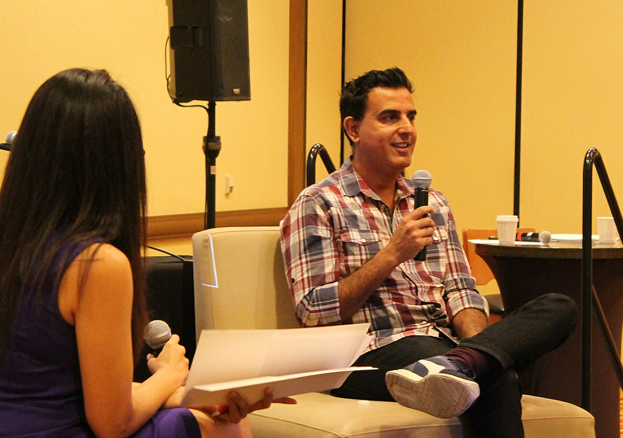 Keynote speaker Razor Suleman shares his startup lessons with the audience during a Fireside Chat with Sehr Charania.