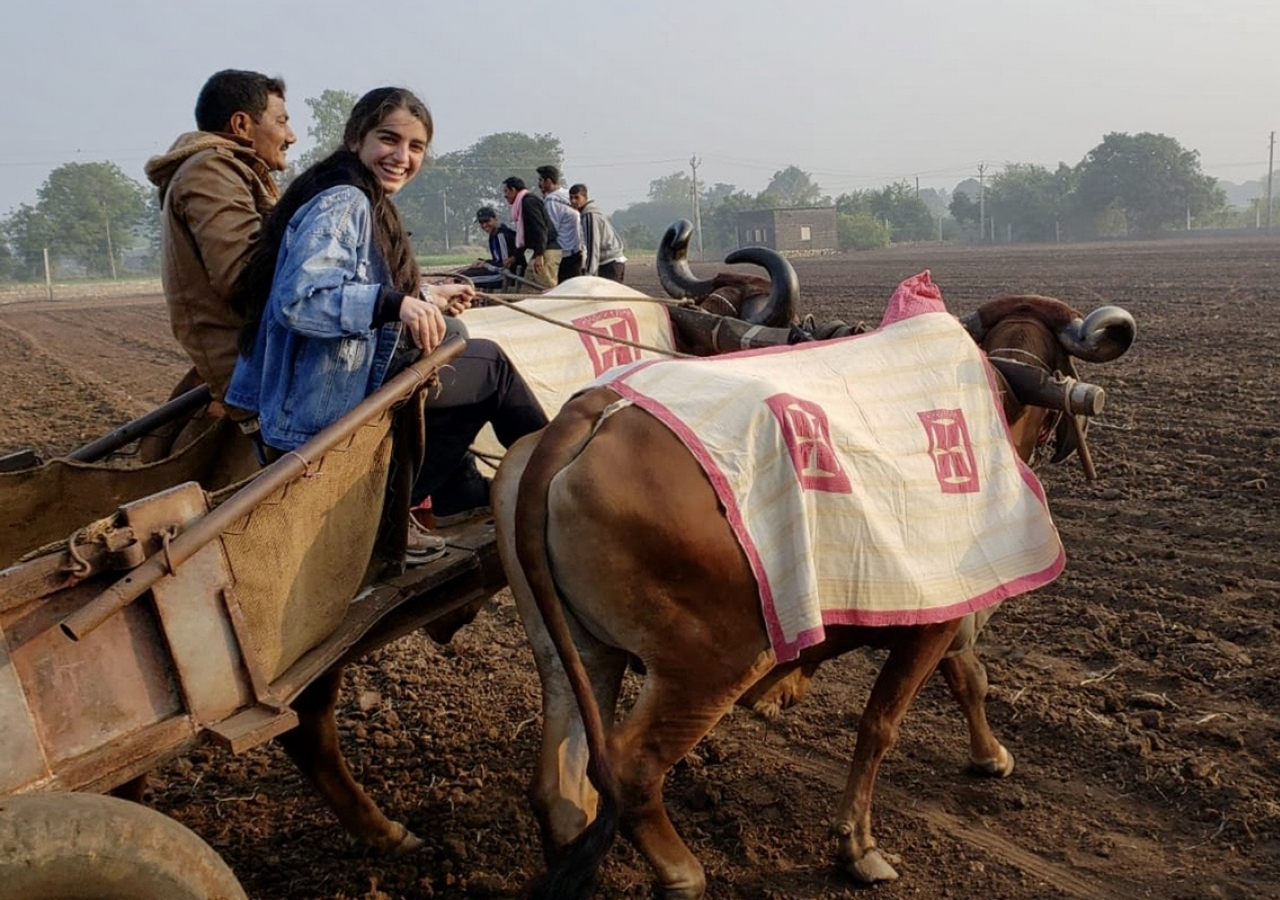 A day in the life of a farmer: GE Expedition participants join in an early morning excursion with Ismaili farmers.