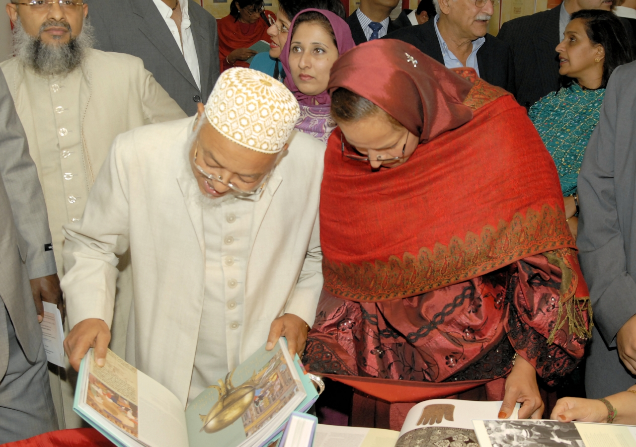 "Attendees at the book launch event examine copies of ""The Ismailis: An Illustrated History."""