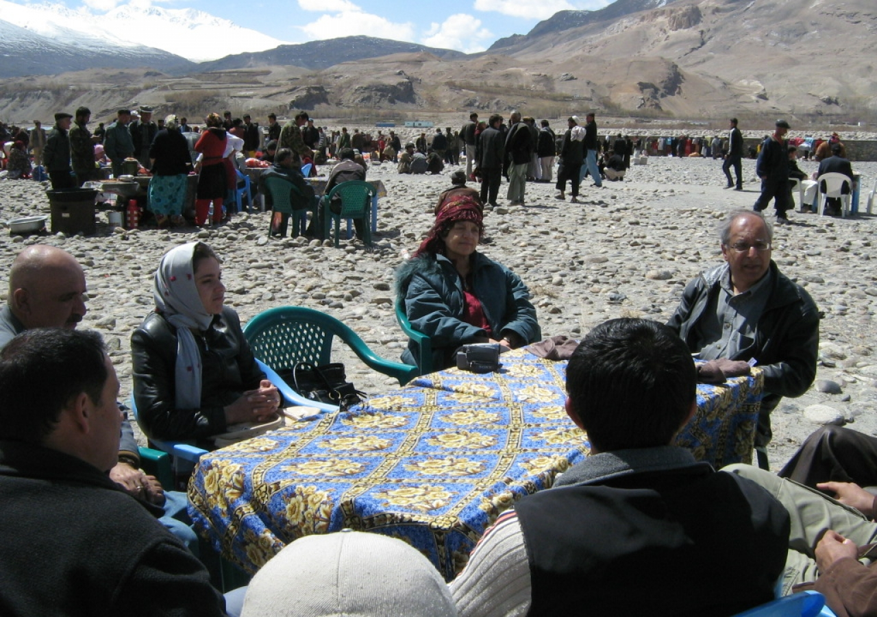 Nashir Karmali (right) attends a meeting with the Afghan Ishkashim team at the Border Market.