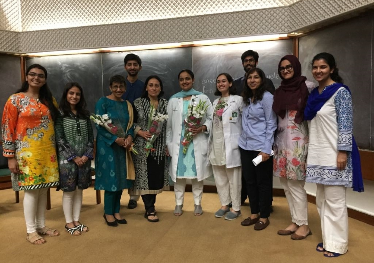 Dr Anees Chagpar (3rd from left) and Dr Farin Amersi (4th from left) pose for a photograph with AKU medical students.