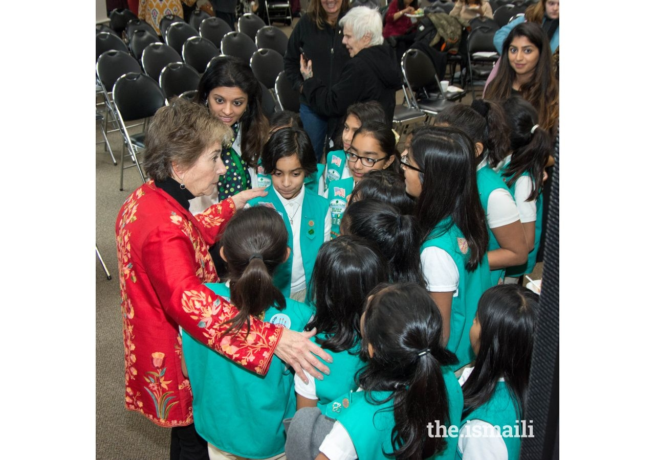 Congresswoman Jan Schakowsky with Ismaili Muslim Girl Scouts at the Thanksgiving event held at the Ismaili Jamatkhana, Glenview, Illinois.