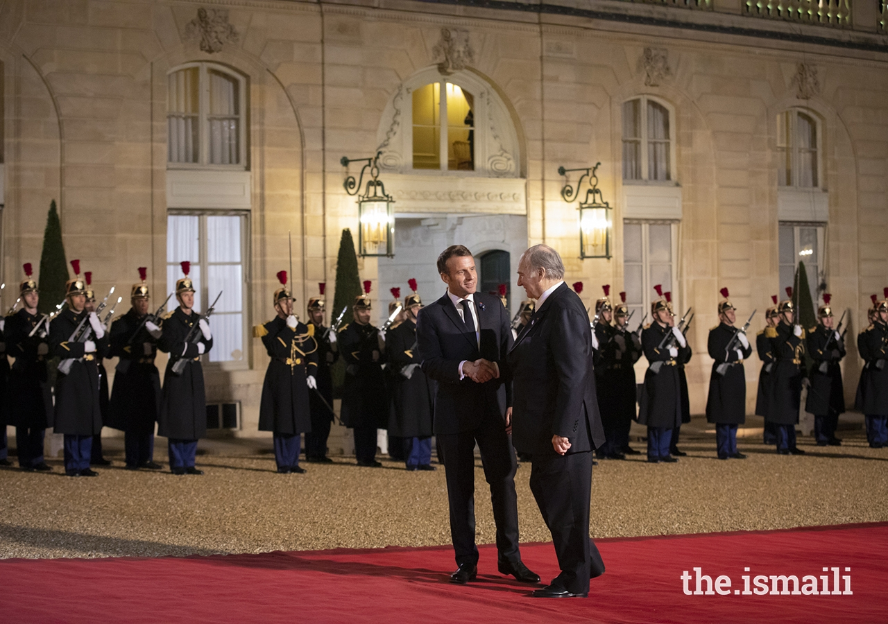 President Emmanuel Macron greets Mawlana Hazar Imam in the courtyard of the Élysée Palace.