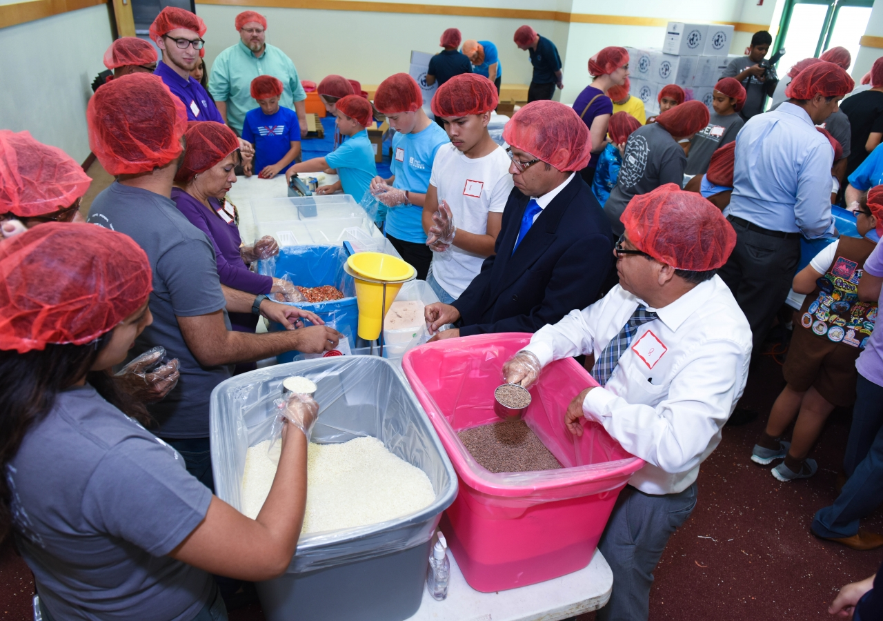 Donning hairnets, all volunteers concentrate to pack an exact weight of each ingredient.