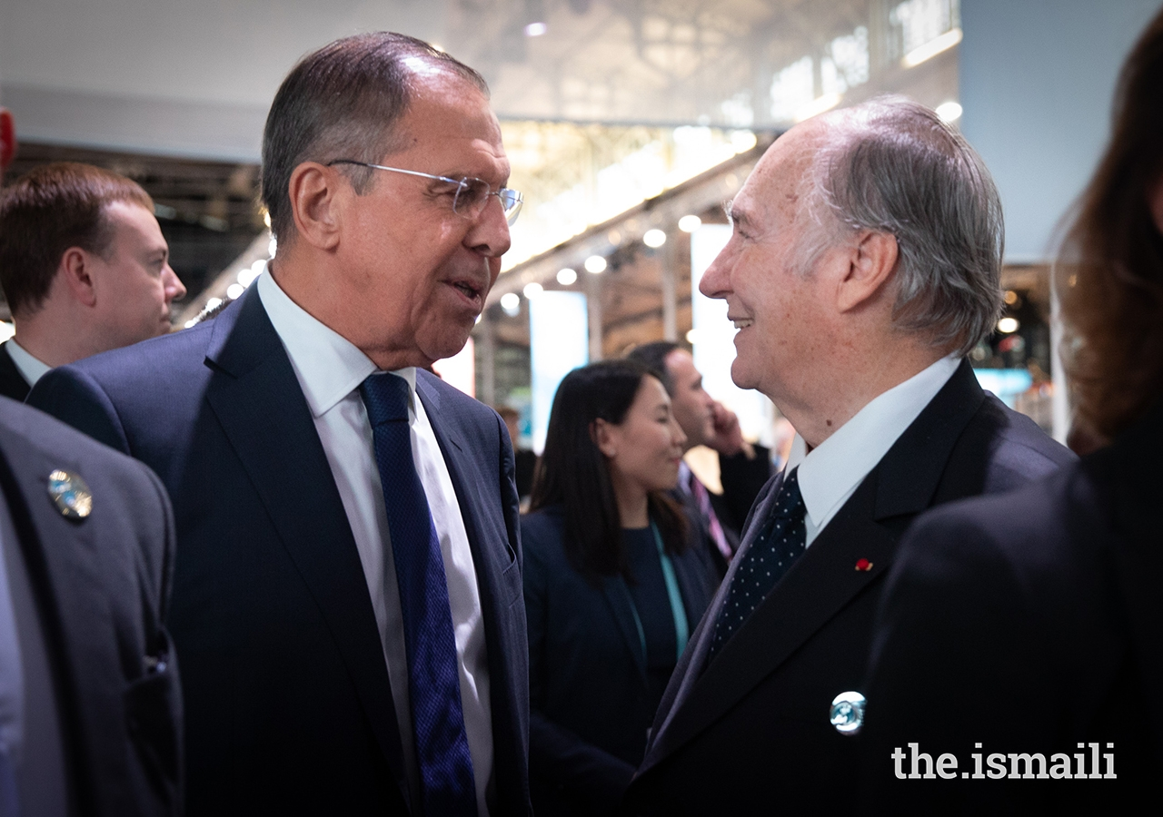 Mawlana Hazar Imam greets Russian Foreign Minister Sergey Lavrov during the opening session of the inaugural Paris Peace Forum.